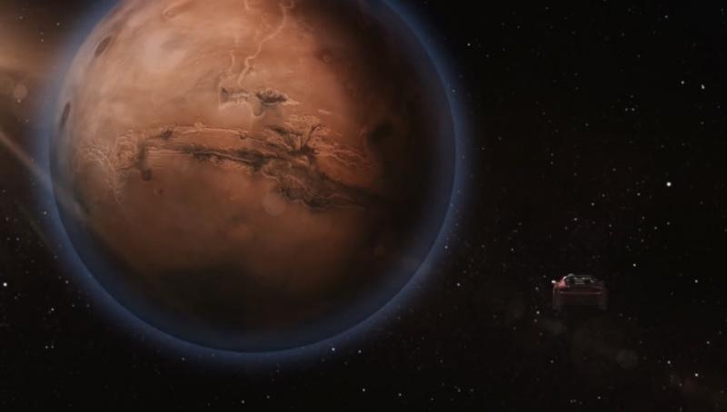 Animacja - auto Tesla w pobliży Marsa (źródło: youtube.com/screenshot)