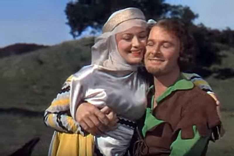 "Olivia de Havilland i Errol Flynn, czyli Lady Marion i Robin Hood (kadr z filmu ""Przygody Robin Hooda"")"